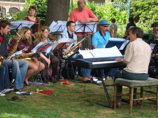 close-up of band members in Paviliion Gardens,